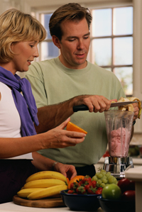 Man and Woman Making Fruit Smoothie