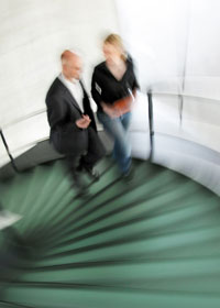 Man and woman walking up stairs -- blury